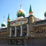 "<p><strong>Location</strong>: Mitchell, South Dakota</p> <p><strong> Address</strong>: 604 North Main Street Mitchell, SD 57301</p> <p>The ingenuity of Corn Palace is only fully realized when visitors discover that the entire outside façade is plastered with individual ears of corn. The outer ""murals"" as they're called are changed every year and feature decorations as detailed as Mount Rushmore. Corn Palace was created in 1892, first called, The Corn Belt Exposition. Farmers put their corn on display to on the building exterior to prove that South Dakota soil was indeed fertile. The current building pays homage to corn belt history and is home to the yearly Corn Palace Festival in August.</p>"