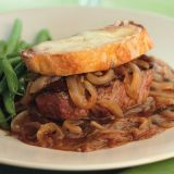 "<p>The comforting flavors of French onion soup in an easy, bistro-style steak dinner! Tender filet mignon gets smothered with sweet caramelized onions and topped by a crispy, Swiss cheese-covered crostini.</p> <p><strong>Recipe:</strong> <a href=""../../../recipefinder/french-onion-beef-tenderloin-recipe-ew1110"" target=""_blank""><strong>French Onion Beef Tenderloin</strong></a></p>"