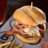 "<p>Michael Symon, <a href=""http://www.foodandwine.com/best_new_chefs/michael-symon"">Food and Wine Best New Chef 1998</a>, specializes in ""meat on meat"" burgers at his Ohio-based chain B-Spot. Named after his Cleveland flagship, the Lola Burger could almost double as a breakfast sandwich, since it's piled with bacon and a fried egg (in addition to pickled red onions, cheddar cheese and mayo).</p><p><a href=""http://www.bspotburgers.com"" target=""_blank""><i>bspotburgers.com</i></a></p>"