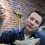 "<p>A woman who was celebrating her wedding anniversary at Jamie's Italian, Jamie Oliver's UK-based chain, found herself violently ill for five hours after her meal. The reason? The restaurant served her ordinary pasta though she suffers from Celiac disease and had requested a gluten-free version. As a result, the restaurant has been slapped with a £9,212 ($14,000) fine for the error.</p>  <p><a href=""/food/recalls-reviews/celiac-woman-sues-jamie-oliver-restaurant-for-being-served-gluten-based-pasta""><b>Read the Whole Story</b></a></p>"
