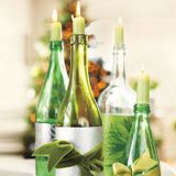 <p>Transform empty glass bottles into holiday candleholders. Add a sophisticated touch with wrapping paper and a giant velvet bow. </p>