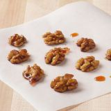 "<p>Use these pretty candied walnuts as a dessert garnish. Or just snack on them plain for a sweet and crunchy treat.</p> <p><b>Recipe: <a href=""http://www.delish.com/recipefinder/candied-walnuts-recipe-ew1211"">Candied Walnuts</a></b></p>"
