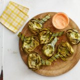 "<p>A little sweet, smoky, and spicy, these simple grilled artichokes make an unexpectedly delicious appetizer or party dish.</p> <p><b>Recipe: <a href=""http://www.delish.com/recipefinder/grilled-artichokes-harissa-honey-dip-recipe-clx0514?click=recipe_sr""> Grilled Artichokes with Harissa-Honey Dip</a></b></p>"