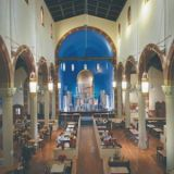 "<b>Location:</b> Pittsburgh, PA<br /> <b>In a Past Life:</b> Church<br /><br /> In 1902, the cornerstone of St. John the Baptist Church was laid on Liberty Avenue. Today, patrons flock to the building not for worship but for burgers, pizza, pierogies, and beer. The <a href=""http://www.churchbrew.com/"" target=""_blank"">Church Brew Works</a>, which opened in 1996, looks like a church on the outside and still contains reminders of the building's past life on the inside. Original pews serve as restaurant seating, eight original lanterns still hang, and the alter area reamins intact, albeit with some very different objects occupying the once sacred space: steel and copper beer brewing tanks. The popular Pittsburgh restaurant brews roughly 2,000 barrels of beer every year, including some that sit in oak casks for one to three years."