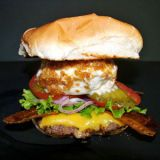 "<p><b>Tampa, Feb. 9-20, 2012</b></p><br />  <p>One Florida State Fairgoer rationalized the appeal of a cheeseburger topped with deep-fried ice cream by describing the salty-sweet hybrid as a ""milk-shake burger.""</p>"