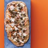 <p>American farmers harvest more than a million acres of potatoes each year, making it the country's top vegetable crop. Both the sweet and white kinds appear along with olives and feta on the flatbread here, which is baked until the edges of the potatoes crisp and the cheese starts to melt.</p>
