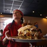 "<p>In February, we reported on the Heart & Soul Café, a restaurant near Phoenix, AZ, that serves a massive breakfast. Just how massive? The dish, called ""The Famous Suicide Stack,"" has four types of meat, two types of gravy, carbs, eggs, and cheese, and weighs in at over 15 pounds!</p><br />  <a href=""/food/recalls-reviews/phoenix-cafe-serves-up-massive-breakfast-belly-bomb""><b>Read the Whole Story</b></a>"