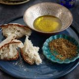 """<p>Dukka (from the Arabic for """"to pound"""") refers to crushed nuts and seeds traditionally eaten on bread dipped in olive oil; the blend varies from cook to cook. Eric Monkaba especially likes this garlic-free version.</p><p><b>Recipe: </b><a href=""""/recipefinder/hazelnut-dukka-recipe-fw0212"""" target=""""_blank""""><b>Hazelnut Dukka</b></a></p>"""