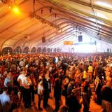<p>Every February, celebrity chefs head down to South Beach Wine & Food Festival in Miami, Florida, for the burger battle royale: the annual Amstel Light Burger Bash. What's even better? More than 1,000 tasters get to sample each and every one — if they can cough up the $225 admittance fee and fight the crowds. Inside the (smoke-filled) beachside tents, 28 top competitors square off. Past chefs in the burger ring have included Richard Blaise and Spike Mendelsohn of <i>Top Chef</i> and Food Network's Bobby Flay and Guy Fieri. Once the competition starts, the chefs craft, season, and sizzle more than 7,500 pounds of beef to serve the 48,000 patties. <i>Iron Chef</i> Michael Symon took home the 2011 trophy for his Yo! Burger topped with fried salami, melted provolone, shasha sauce, and pickled onions. This year TK won with TKTKTKTK.</p>