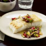 """<p>This easy fish dish is topped with a quick homemade relish of olives, lemon, and fresh red and yellow tomatoes.</p><br /><p><a href=""""/recipefinder/halibut-tomato-olive-seafood-recipes""""target=""""_new"""">Get this Recipe!</a></p>"""