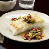"This easy fish dish is topped with a quick homemade relish of olives, lemon, and fresh red and yellow tomatoes.<br /><br /> <b>Recipe:</b> <a href=""/recipefinder/halibut-tomato-olive-seafood-recipes""target=""_new"">Halibut with Tomato, Olive, and Pine Nut Relish</a>"