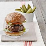 """<p><b>Ming Tsai: Chef-owner of Blue Ginger in Wellesley, MA</b></p> <p>""""The thing I love about a burger is that you get all the flavors together in one bite,"""" says Tsai. His secret? A tangy hoisin-lime glaze applied while the beef is cooking.</p> <p><b>INGREDIENTS</b>: Soft sesame bun, toasted on the grill for extra texture, avocado, tomato, sharp Vermont Cheddar, grass-fed ground chuck (80 percent lean), shredded iceberg lettuce, a mix of Dijon mustard and red chili paste (like sambal), hoisin-lime sauce</p><p><b>Related Recipe: <a href=""""/recipefinder/hoisin-lime-sauce-recipe"""" target=""""_blank"""">Hoisin-Lime Sauce</a></b></p>"""