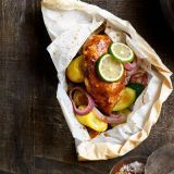 "Baking chicken in packets keeps the moisture and flavor of Mexican beer with fresh zucchini, squash, and onions inside.<br /><br /><b>Get the recipe: <a href=""/recipefinder/mexicana-chicken-recipe""target=""_blank"">Mexicana Chicken</a></b>"