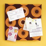 "<p>Create a handy spot to pin up coupons, grocery lists and receipts in your kitchen. Simply wrap a 12-inch square cork tile (Acco Brands, $7 for pack of 4, <a href=""http://www.amazon.com""target=""_new"">amazon.com</a>) with a towel, as if wrapping a package. Use a glue gun to adhere the edges. Hang using mounting tape.</p>"