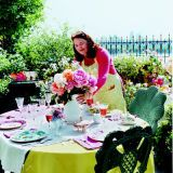 "The warm days of May offer the perfect environment for an outdoor gathering, and no one knows that better than Pamela Scurry, an entertaining expert and owner of Pamela Scurry's Wicker Garden in New York City. ""There's a freshness, a spontaneity you feel when you entertain outdoors,"" says Pamela, who often entertains on her spacious terrace. ""It entices the senses."" Pamela pays thoughtful attention to all the details that go into a fabulous fete -- and has fun doing it. See how she crafts her imaginative ideas to make an occasion special. <br><br> When entertaining, Pamela often uses everyday items such as coffee creamers or urns as vases. ""I collect coffee urns,"" she says. ""They're inexpensive and I love the way they look."""