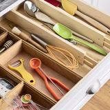 Bring order to utensils with spring-loaded drawer dividers, like these easy-to-install sorters by Improvements ($20 for two). They'll keep your spoons and spatulas separate from your tongs and timers, so you can grab whatever you need in the heat of the moment. Tiny items, like measuring cups and spoons, won't get lost in the fray, either, when contained in shallow bins. <i>Wooden drawer dividers, $20, Improvements Catalog; 800-642-2112. Drawer liner, $3, and bamboo drawer organizers, $4 to $7, The Container Store; 800-786-7315.</i>