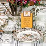 <p>Antique turkey-themed transferware with its rich colors and patterns, inspired the mix-and-match look of the table. Multidimensional menu cards add an even more personal touch.</p>