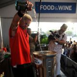Guy Fieri knows how to wow a crowd. During his culinary demo, Fieri took a cue from Tom Cruise in <i>Cocktail</i> to prepare his ice-cold beach beverage.