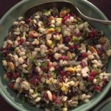"<p>Simple yet sophisticated, this pilaf marries the chewy texture of barley and wild rice with the buttery crunch of toasted pine nuts and the fresh tang of pomegranate seeds. The plentiful seeds of the pomegranate are said to represent the 613 mitzvot, or good deeds the Torah obliges us to do.</p><br /><p><b>Recipe: <a href=""/recipefinder/barley-wild-rice-pilaf-pomegranate-seeds-recipe-10027"" target=""_blank"">Barley and Wild Rice Pilaf with Pomegranate Seeds</a></b></p>"