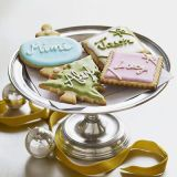 """The sweet aroma of sugar cookies baking in the oven is a fond holiday memory. A dash of lemon extract in the batter keeps things lively. Add decorative icing for fun, edible place cards.<br /><br /><b>Recipe: <a href=""""/recipefinder/lemon-sugar-cookies-dessert-recipes"""" target=""""_blank"""">Lemon Sugar Cookies</a></b>"""