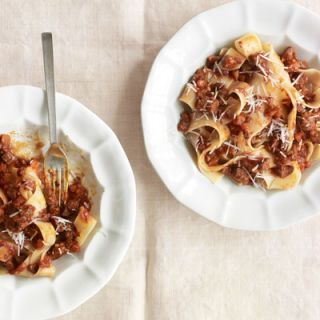 """<p>A stick-to-your ribs tomato sauce of brisket, bacon, and red wine calls for a pasta with equal gusto. This wide, ribbony egg noodle fits the bill.</p><p><strong>Recipe:</strong> <a href=""""/recipefinder/pappardelle-beef-ragu-recipe-clv0512"""" target=""""_blank""""><strong><b>Pappardelle with Beef Ragu</b></strong></a></p><p> </p><p>Carrots: $0.75 <br />Onion: $0.24 <br />Garlic: $0.70 <br />Bacon: $2.30 <br />Beef brisket: $8.25 <br />Tomato paste: $0.84 <br />Tomatoes: $2.90 <br />Red wine: $6.00 <br />Pappardelle: $3.79 <br />Pecorino: $2.93 <br /><br /><strong>TOTAL:* $28.70</strong> (for six servings) <strong>