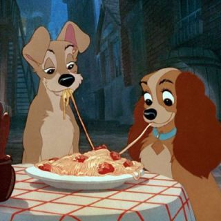In one of the most classic movie images of all time, Lady and the Tramp share spaghetti — only to realize they're eating the same noodle. (Aww.)