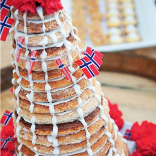 Kransekake — a cake made from almonds, sugar, and egg whites enjoyed on special occasions like Christmas and weddings — has a sweet structure: it gets its cone shape from many concentric rings stacked and held together with icing.