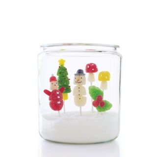 "<p>Turn gumdrops into adorable Christmas pops that look like Santa, snowmen, decorated trees, holly, and toadstools. Older children will love to make these gumdrop pops themselves.</p> <p> Stack gumdrops, dot them with sprinkles and other candies in creative ways, and watch the colorful confections come to life as snowmen, Santas, and other icons of the season. Wrap the candy pops in cellophane bags, and then attach them to gifts or slip them into stockings. Or create a holiday display: Partially fill a large glass jar with sanding sugar, and stand the figurines on flower frogs in the sparkling ""snow.""</p><p>  Slide gumdrops onto candy sticks to create body of each pop. (Use leaf-shaped gumdrops for holly pop.) </p>  <p><b>For Santa</b>:</p> <p>Use top half of 1 small gumdrop for hat. Trim 2 oblong candies for arms. Use candy-coated seeds for buttons and pom-pom. Poke candy where facial features will go with a skewer; Use sticky tip to pick up and place nonpareils for eyes and nose.</p><p>  <b>For Tree</b>:</p> <p>Use 1 flattened gumdrop for base of tree. Use 1 small gumdrop for trunk. Cut sides from 1 gumdrop; press sides around top of stick, for treetop. Flatten 1 gumdrop; using an aspic cutter, cut out star. Insert sprinkles for lights.</p>  <p><b>For Snowman</b>:</p> <p>Trim top of head; top with 1 candy wafer and half of 1 small gumdrop for hat. Using a skewer (see ""For Santa""), place nonpareils for eyes, mouth, and buttons. Insert sprinkle for nose.</p>  <p><b>For Holly</b>:</p> Use halves of small gumdrops for berries.   <p><b>For Mushroom</b>:</p> <p>Use 1 small gumdrop for stem. Use sequin sprinkles for dots.</p>"