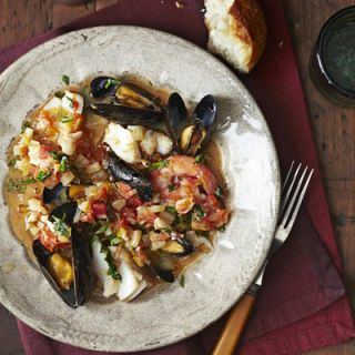 <p>Slow cooking the liquid and vegetable base for this stew loads it with flavor, and throwing the seafood in toward the end of cooking keeps it sweet and tender.</p>