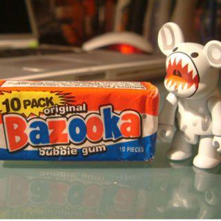 เมื่อ it comes to Bazooka, it's all about the packaging. First marketed after World War II, the chewing gum featured a patriotic red, white, and blue color scheme. But even more unforgettably, each wrapper includes a small comic strip featuring the always-eyepatched Bazooka Joe.