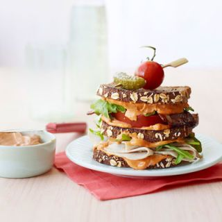"""<p>Adding sriracha to hummus is an easy way to make a delicious spicy condiment, one that pairs perfectly with this turkey club.</p> <p><strong>Recipe:</strong> <a href=""""../../../recipefinder/turkey-spicy-hummus-clubs-recipe-ghk0812"""" target=""""_blank""""><strong>Turkey and Spicy Hummus Clubs</strong></a></p>"""