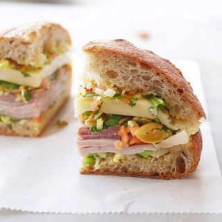 """<p>This sandwich was born in New Orleans, and tastes best when refrigerated for a few hours after assembly to let the flavors meld together.</p> <p><strong>Recipe:</strong> <a href=""""../../../recipefinder/muffulettas-recipe-ghk0812"""" target=""""_blank""""><strong>Muffulettas</strong></a></p>"""