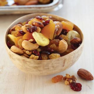 <p>Whether you're hosting a classy wine and cheese night or just having some friends over to watch the game, a fruit-and-nut mix is always a hit, and pairs well with whatever kinds of drinks you might have on hand. If you're opening up your home for a more casual bash, serve a spicy, savory mix with some cold, crisp beers, or look for a sweeter blend with lots of dried fruit (like the mix pictured) to pair with bold red wines and a soft cheese. Any supermarket will have a variety of mixes, so you should find an option for every kind of party.</p>