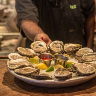 "Mon-Fri: 3-6 p.m. <br /><br /> Celebrity chef John Besh's bistro sells 50-cent gulf oysters and half-priced cocktails like an icy absinthe frappe and a classic sazerac. <br /><br /> <a href=""http://www.lukeneworleans.com/"" target=""_blank"">lukeneworleans.com</a>"