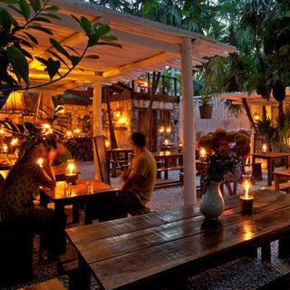 "<p>There are no ovens, induction burners, or even walls at this small, open restaurant on Mexico's Yucatán peninsula. Here, chef Eric Werner uses only a grill or a wood-burning oven to prepare bold dishes such as slow-roasted pork belly with smoky-sweet pineapple. Drinks, like his spicy grapefruit margarita, are mixed in a hut made of whitewashed branches.</p><p><a href=""http://www.hartwoodtulum.com"" target=""_blank""><i>hartwoodtulum.com</i></a></p>"