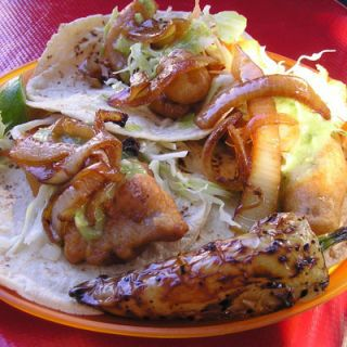 undisputed destination for tacos de pescado is San Diego, because of its proximity to Baja California, the region of Mexico where this handheld meal was first created. Head to the original, Rubio's, for a taste of battered, fried fish, dressed with cabbage and sauce on a tortilla.