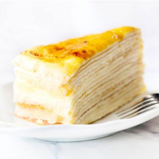 "In 2004, Lady M Cake Boutique's ethereal cake made of 20-plus crêpes layered with pastry cream and finished with a crispy brûléed topping became a favorite in New York when the confectioner opened its first stand-alone shop (previously, the cakes had been available only at Takashimaya and Dean & DeLuca). Not long after, in 2005, Amanda Hesser deemed it the <a href=""http://www.nytimes.com/2005/05/15/magazine/15FOOD.html?pagewanted=all&_r=0"" target=""_blank"">city's ""second best cake""</a>). Lady M has since expanded upon its classic vanilla recipe (which remains a trade secret) to flavors ranging from chocolate-banana to green tea. The fact that Lady M is still growing (a new location recently across from Bryant Park) is evidence of the confection's enduring appeal."
