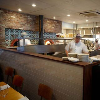 "Since relocating to a larger space down the street from its original home, this chef-adored, locally driven pizzeria has room for two wood-burning ovens, both built by Valoriani — a family-run Florentine company in business since 1890. Each oven is covered with beautiful tiles that Franny's owners Francine Stephens and Andrew Feinberg sourced from Mexico. Must try: Fresh clam pizza with chiles and parsley. <br /><br /> <a href=""http://frannysbrooklyn.com/"" target=""_blank"">frannysbrooklyn.com</a>"