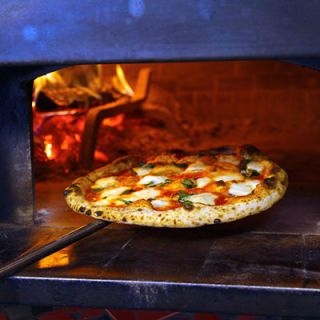 "The 11-time World Pizza Champion Tony Gemignani uses eight ovens, each calibrated to cook a different pizza style. Gemignani's arsenal includes an electric oven that reaches 700 degrees for long, thin Roman-style pizza; a wood-fired brick oven set to 900 degrees for puffy, crispy-crusted Neapolitan pizzas; and a coal-fire oven set to a scorching 1,000 degrees for charred thin-crust pizza in the old-school New York-style. Must try: Gemignani's perfect Margherita with fresh cow-milk mozzarella, which took first prize at the World Pizza Cup in Naples. <br /><br /> <a href=""tonyspizzanapoletana.com"" target=""_blank"">tonyspizzanapoletana.com</a>"
