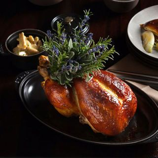 "<p>Daniel Humm's baroque chicken for two is fit for plutocrats, with a stuffing of foie gras, truffle and brioche piped under the skin before roasting.</p>  <p><a href=http://www.thenomadhotel.com"" target=""_blank"">thenomadhotel.com</a></p>"