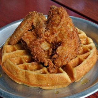 "<p>With extra-craggy triple-fried chicken paired with a thick, custardy Belgian waffle, Ashley Christensen's take on chicken and waffles is ""all about the textures,"" she says.</p>  <p><a href=""http://www.ac-restaurants.com/"" target=""_blank"">ac-restaurants.com</a></p>"