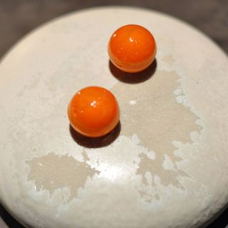 "<p>Featuring Chef Rasmus Kofoed, Geranium has wracked up its fair share of culinary awards. They offer a tasting menu of 18 courses, which includes this delight. These crunchy spheres, made of carrot and jellified sea buckthorn, are the teasing start your tastebuds' journey.</p> <p><strong>Geranium:</strong> Per Henrik Lings Allé 4, 2100 Copenhagen, Denmark; +45 69 96 00 20; <a href=""http://geranium.dk/#/en/restaurant/welcome/"" target=""_blank"">geranium.dk</a></p>"