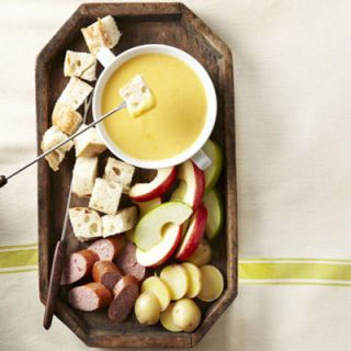"<p>Cheddar and beer make a gorgeous couple. Fondues and spreads show off their compatibility. The Cheddar-Beer Fondue (pictured) is the perfect dipping sauce for potatoes, apples, and sausage. For something even more special, try Potted Cheddar Beer Spread, which borrows flavors from the famous Welsh Rarebit dish.</p> <p><b>Get the recipe: <a href=""http://www.delish.com/recipefinder/cheddar-beer-fondue-recipe-ghk0213?click=recipe_sr""> Cheddar Beer Fondue</a></b></p> <p><b>Get the recipe: <a href=""http://www.delish.com/recipefinder/potted-cheddar-beer-spread-2939?click=recipe_sr""> Potted Cheddar and Beer Spread</a></b></p>"