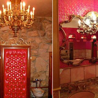 "<p>With stone walls, stall doors of carved wood and tufted pink leather, a gold-tinged mirror, a huge chandelier, marble countertops, and pink wallpaper with a gold-leaf finish, the ladies' room at the <a href=""http://www.madonnainn.com/steakhouse.php"" target=""_blank""></a>Gold Rush Steakhouse in San Luis Obispo's unique Madonna Inn is lavish, gaudy, and simply awesome. </p>"
