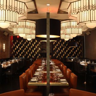 "<p>The Art Deco interiors and gigantic steaks at Marc Forgione's new restaurant evoke an old-school boys' club. <em><a href=""http://americancutsteakhouse.com/"" target=""_blank"">americancutsteakhouse.com</a></em></p>"
