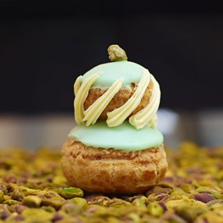 "<p><strong>Salted pistachio religieuse, $5</strong><br /><span>Creator of the pastry sensation, the cronut, Dominique Ansel also offers inspired </span><em>religieuses</em><span> at his downtown bakery. The French classic consists of two stacked cream puffs, and his version is filled with both whipped white chocolate–pistachio ganache (on top), and a custardy, salted pistachio mousseline (on the bottom). </span><em><a title=""Dominique Ansel Bakery"" href=""http://www.dominiqueansel.com/"" target=""_blank"">dominiqueansel.com</a></em></p>"