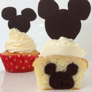 "<p> Disney-fy a birthday with this vanilla cupcake with a Mickey shaped brownie in the middle! This cupcake will be a hit for Disney and Non-Disney fanatics alike!</p> <p><strong>Recipe:</strong> <a href=""https://www.howtocookthat.net/public_html/mickey-mouse-cupcakes-with-mickey-inside/""><strong>Mickey Mouse Cupcake with Mickey inside</strong></a></p>"