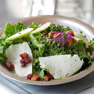 <p>Leave it to Texan chef Tim Love to give a meaty twist to kale salad. House-cured <em>guanciale</em> accompanies three varieties of kale, crisp celery greens, smoked <em>pepitas</em> and shavings of Manchego cheese. A lemony dressing made with rendered fat from the <em>guanciale</em> puts the salad over the top.</p>
