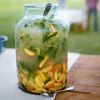 """<p><span>This recipe is a high-low mix of fancy champagne and Lincoln County Lightning Whiskey. Fresh peaches and basil add a taste of summer</span>.</p> <p><strong>Get the recipe <a href=""""http://www.countryliving.com/recipefinder/bellini-moonshiners-recipe-clv0813"""" target=""""_blank"""">here</a>.</strong></p>"""