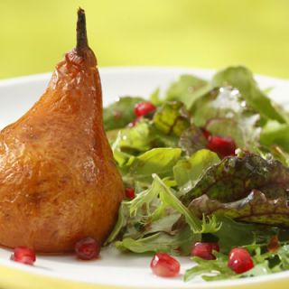 "<p>Here we serve roasted pears with arugula and mixed greens and an agave-sweetened pomegranate dressing. The chipotle in the dressing gives a hint of smokiness and just a touch of heat that is wonderful with sweet pear. Apples may be used in place of the pears.</p><br /> <p><a href=""/recipefinder/roasted-pear-arugula-salad-pomegranate-chipotle-vinaigrette-recipe-6751"" target=""_blank"">Get the recipe!</a>"